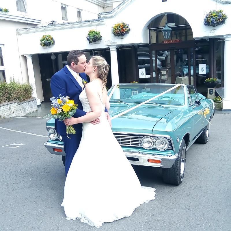 Happily married couple Chevrolet Malibu