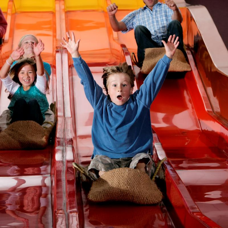 Children having fun on the helter skelter at The Milky Way